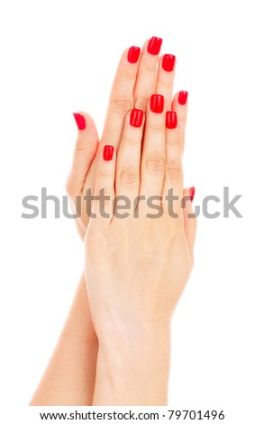 beautiful red manicure isolated on white - stock photo
