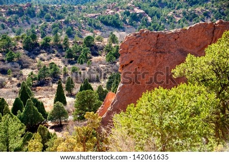 Beautiful red rock mountain appears to show a smile - stock photo