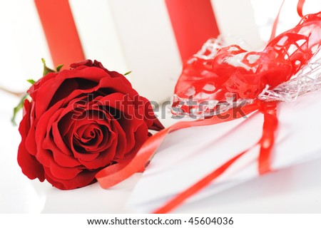 beautiful red rose and letter with ribbon close up