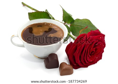 Beautiful red rose, cup of coffee and chocolate candies isolated on white background - stock photo