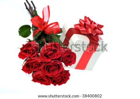 beautiful red roses and present with ribbon