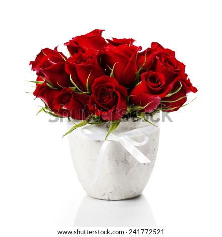 Beautiful red roses in a vase isolated on white - stock photo