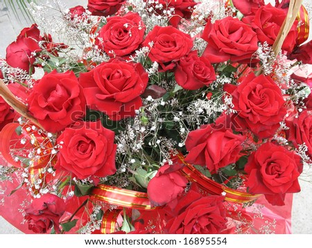 Beautiful red roses with tapes bouquet colorful background