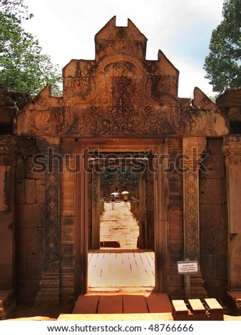 Beautiful red sandstone carvings at the Banteay Srei temple (temple of women) near Angkor Wat (Siem Reap, Cambodia).