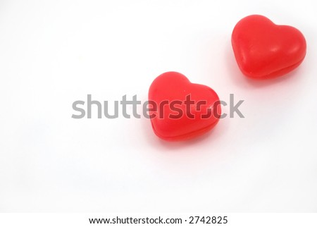 Beautiful red soap as heart on a white background