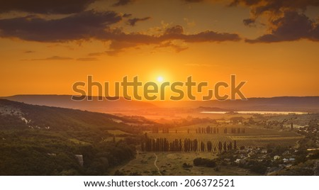 Beautiful red sunrise above the Crimea mountain valley
