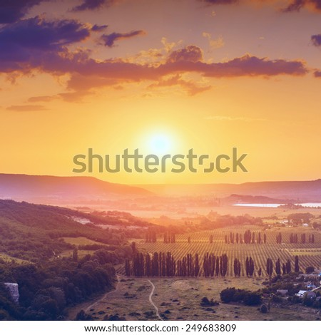 Beautiful red sunrise above the Crimea valley - stock photo