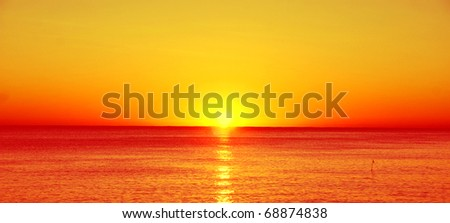 Beautiful red sunset over the sea - stock photo