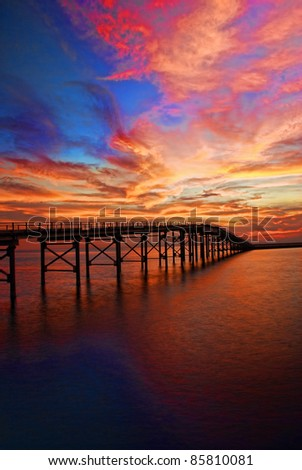 beautiful red sunsets with bridge silhoutte background