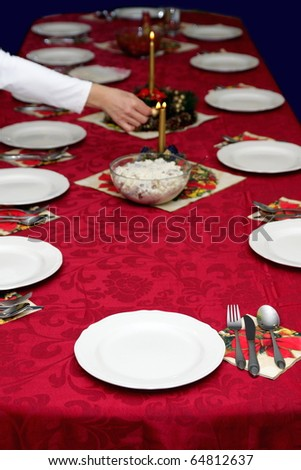 Beautiful red table setting for Christmas - stock photo