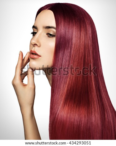 Beautiful red woman with long, healthy, straight and shiny hair. Hairstyle loose hair. Model girl with luxurious smooth straight hair. Hair cosmetics. White background. - stock photo