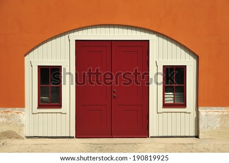 Beautiful red wood door entry on old home.