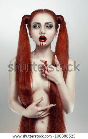 Beautiful redhead bleeding woman - stock photo