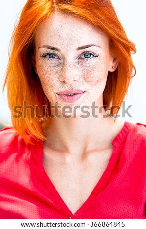 Beautiful redhead freckled woman smiling seductive - stock photo