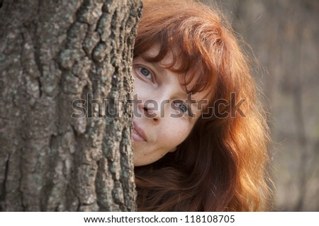beautiful redhead girl in the park