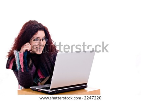 Beautiful redhead having fun with laptop over white background. - stock photo