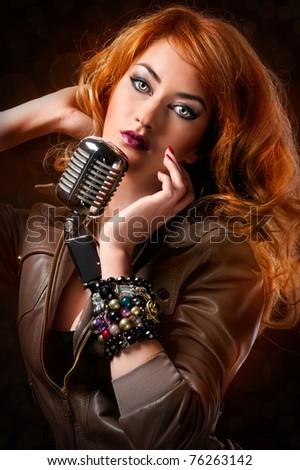 Beautiful redhead singer - stock photo