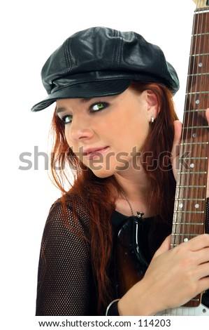 Beautiful  redhead with an electric guitar. 