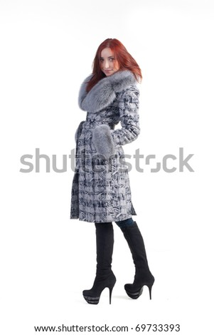 beautiful redhead woman in grey coat isolated on white - stock photo