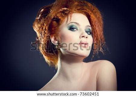 Beautiful redhead woman. Perfect classy hair style and makeup. - stock photo