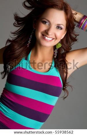 Beautiful redhead woman smiling - stock photo