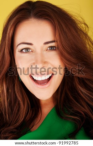 Beautiful redhead woman with an excited and happy expression, close-up studio - stock photo