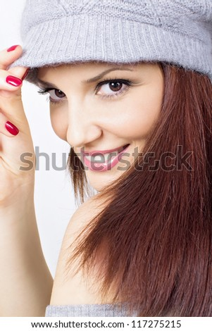 Beautiful redhead woman with gray hat