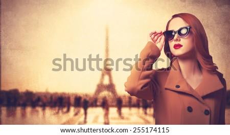 Beautiful redhead women in sunglasses on parisian background.  - stock photo