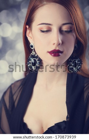 Beautiful redhead women with earrings.