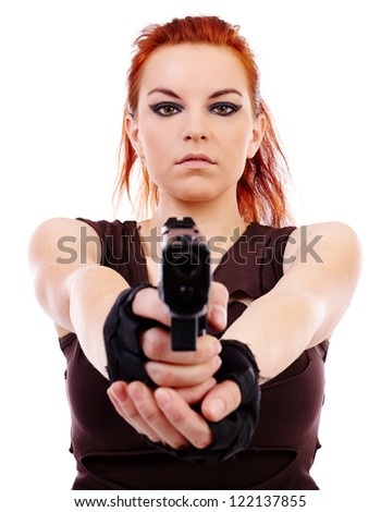 Beautiful redhead young woman with gun, holster and military outfit, isolated on white background - stock photo