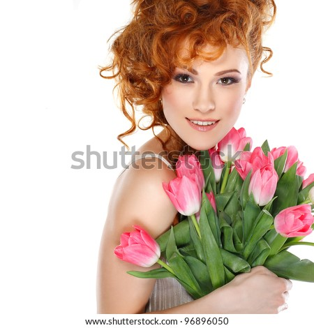 Beautiful redheaded girl with the bouquet of tulips isolated on a white background
