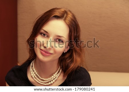 beautiful redheaded woman relaxing in a cafe