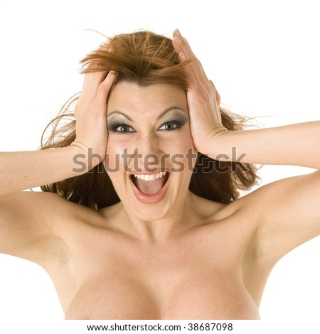 Beautiful redheaded woman screaming crazily - stock photo