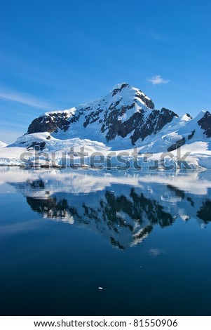 Beautiful reflecting mountain and glaciers in Paradise Bay, Antarctica - stock photo