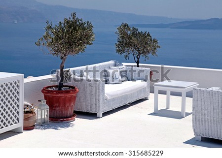 Beautiful relax sea view terrace with white sofa, Santorini island, Greece. Selective focus - stock photo