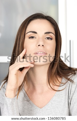 beautiful relaxed young woman at home - stock photo