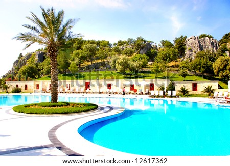 beautiful resort territory with swim pool - stock photo