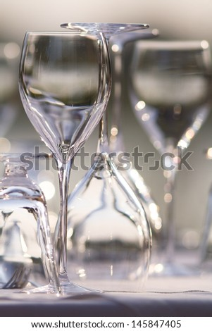 Beautiful restaurant setting of glasses and cutlery on a table
