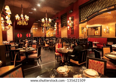 beautiful restaurant with a romantic couple eating - stock photo