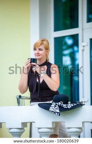 Beautiful resting woman with cup of coffee  - stock photo