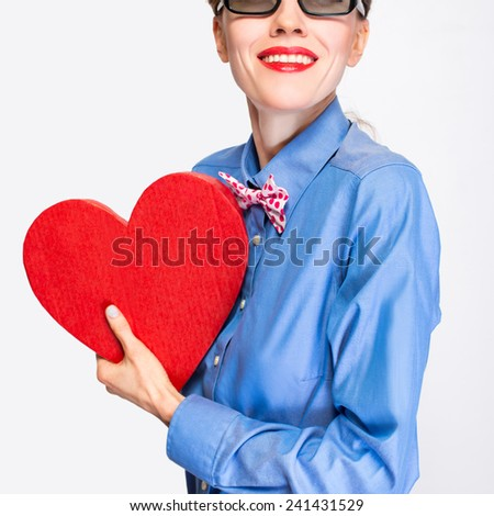 Beautiful retro girl with heart on light background. focus on woman - stock photo