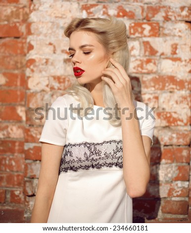 Beautiful retro woman with red lips and blonde hair, summer weather, outdoor - stock photo