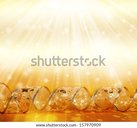 Beautiful ribbon streamers on a gold sparkling abstract background - stock photo