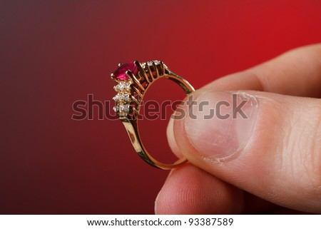 Beautiful ring in his hand - stock photo