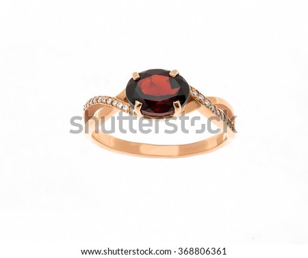 Beautiful ring with garnet isolated on white... - stock photo