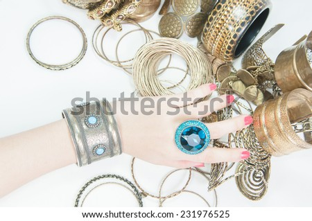 Beautiful rings and bangles on hand.Expensive Gold Jewelry background  - stock photo