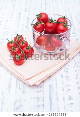 Beautiful ripe tomatoes in a transparent circle. Healthy food. Vegetable diet. Wooden board rustic - stock photo