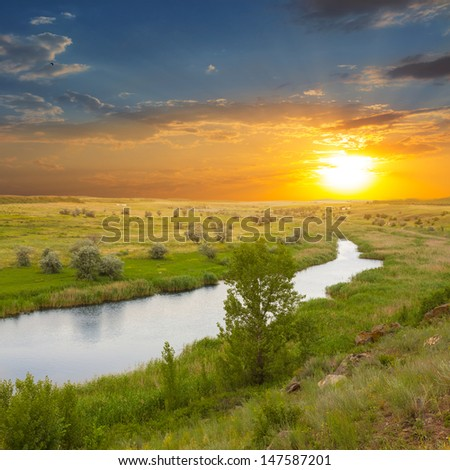 beautiful river at the sunset - stock photo