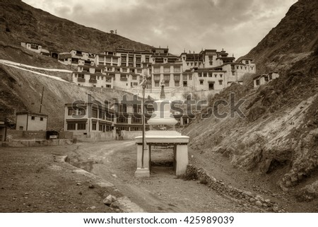 Beautiful Rizong monastery with view of Himalayan mountians - it is a famous Buddhist temple in,Leh, Ladakh, Jammu and Kashmir, India. Nice sepia toned stock image - stock photo