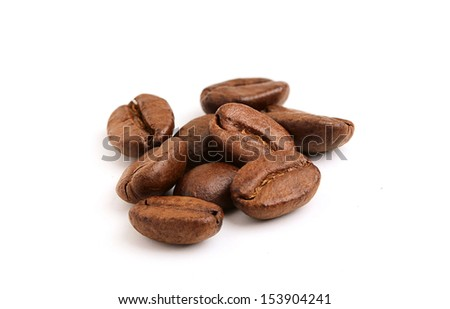 Beautiful roasted coffee grains close up on a white background. - stock photo